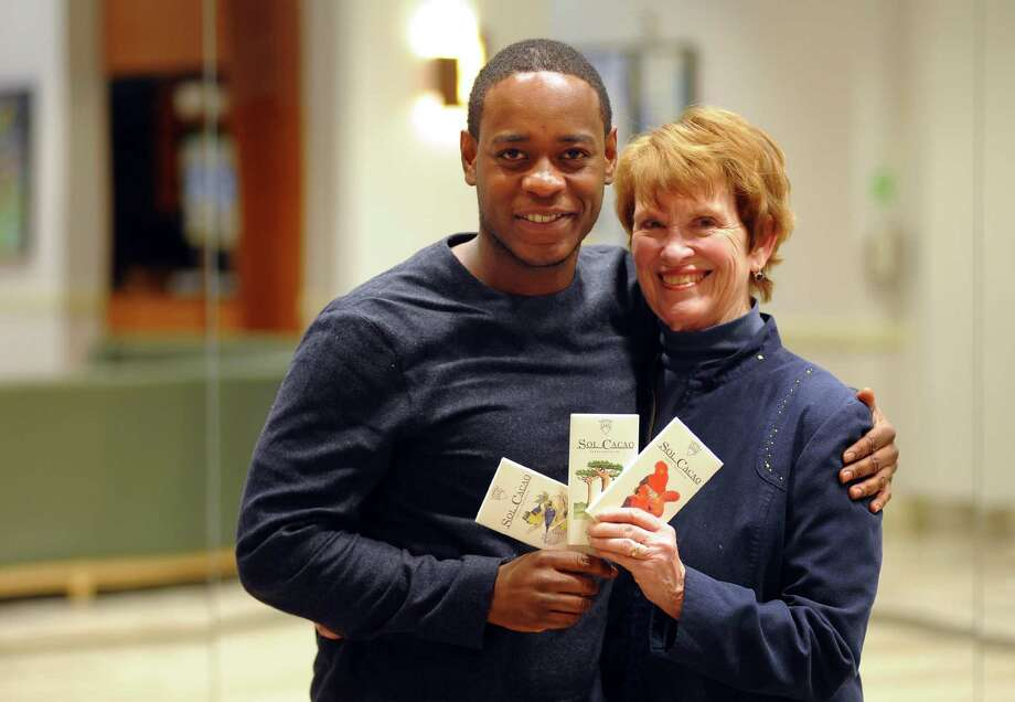 College Assistance Program alum Daniel Maloney, left, poses with Bridgeport Public Education Fund Executice Director Marge Hiller before the start of BPEF's 15th Annual Reunion at the Holiday Inn in Bridgeport, Conn., on Tuesday Jan. 9, 2018. Maloney holds samples of a line of chocolate he produces with his brothers. Photo: Christian Abraham / Hearst Connecticut Media / Connecticut Post