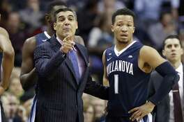 Coach Jay Wright, left, and guard Jalen Brunson and top-ranked Villanova will face UConn in Hartford on Saturday.