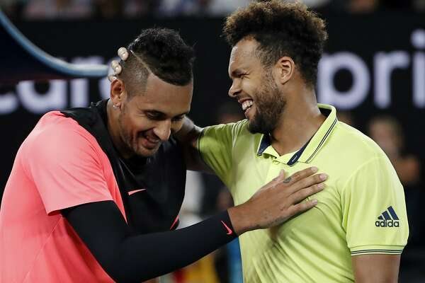 France's Jo-Wilfried Tsonga, right, congratulates Australia's Nick Kyrgios after Kyrgios won their third round match at the Australian Open tennis championships in Melbourne, Australia, Friday, Jan. 19, 2018. (AP Photo/Ng Han Guan)