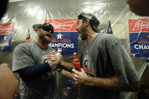 Houston Astros catcher Brian McCann, left, celebrates with pitcher Justin Verlander, right, in the clubouse after Game 7 of the World Series at Dodger Stadium on Wednesday, Nov. 1, 2017, in Los Angeles. ( Karen Warren / Houston Chronicle )