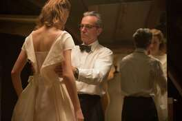 """Vicky Krieps, left, portrays an unrefined waitress who becomes model and muse for a narcissistic dressmaker played by Daniel Day-Lewis in """"Phantom Thread."""""""