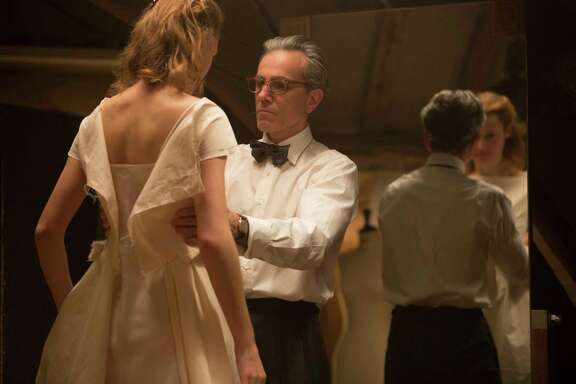 "Vicky Krieps, left, portrays an unrefined waitress who becomes model and muse for a narcissistic dressmaker played by Daniel Day-Lewis in ""Phantom Thread."""