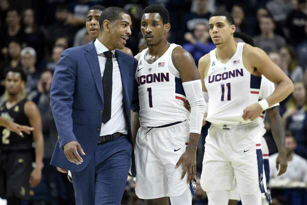 UConn head coach Kevin Ollie, left, and guard Christian Vital take on top-ranked Villanova on Saturday in Hartford.