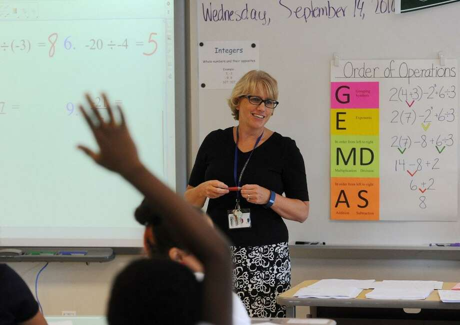 Award winning math teacher Liz Capasso teaches one of her Algebra classes at Jettie Tisdale School in Bridgeport, Conn. on Wednesday, September 14, 2016. Capasso testified in the CCJEF trial which resulted in a recent judge's ruling demanding sweeping changes to school funding. On Jan. 17, 2018 the state Supreme Court reversed the decision. Photo: Brian A. Pounds / Hearst Connecticut Media / Connecticut Post
