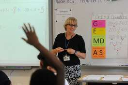 Award winning math teacher Liz Capasso teaches one of her Algebra classes at Jettie Tisdale School in Bridgeport, Conn. on Wednesday, September 14, 2016. Capasso testified in the CCJEF trial which resulted in a recent judge's ruling demanding sweeping changes to school funding. On Jan. 17, 2018 the state Supreme Court reversed the decision.