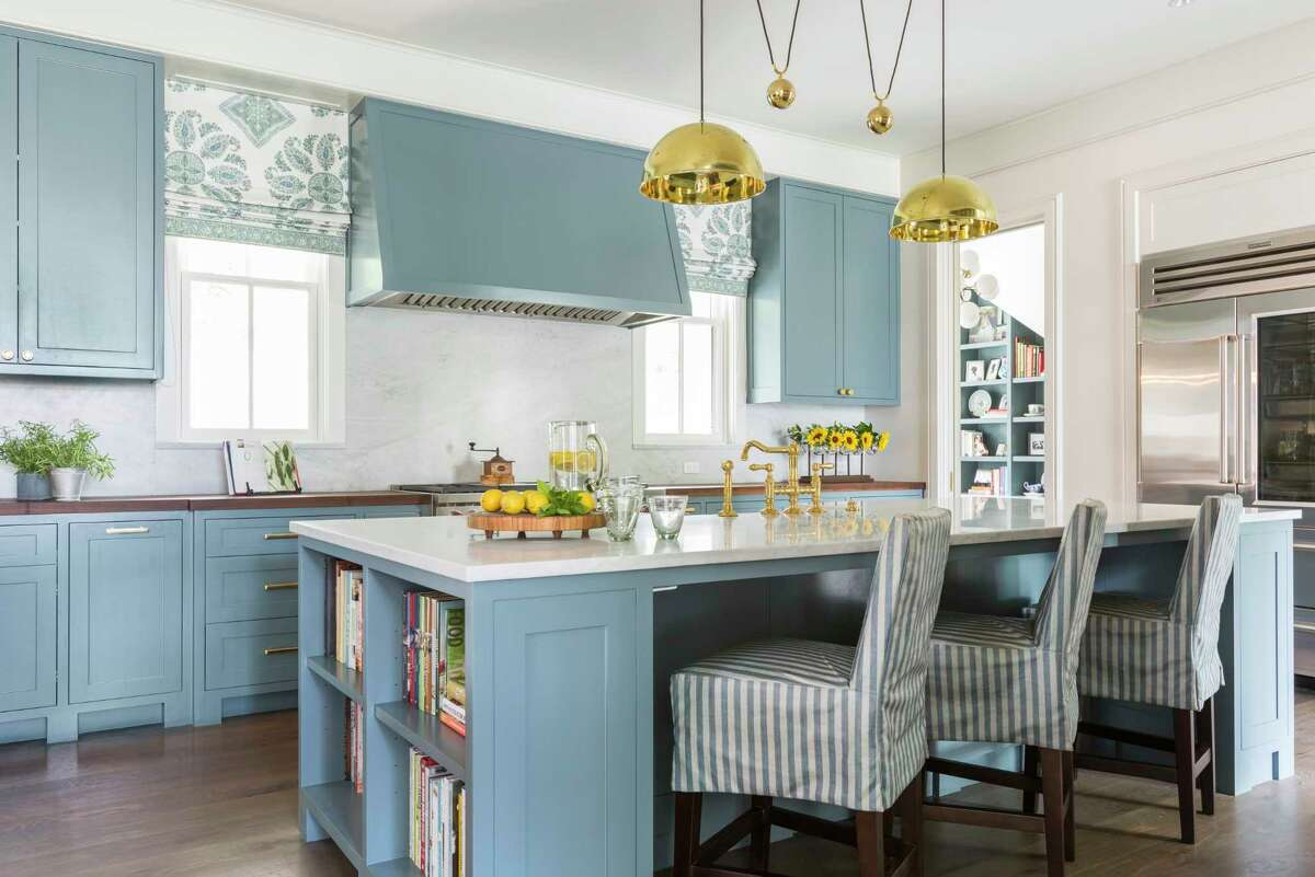 Soft blue colors are found throughout the home, including blue cabinets in the kitchen.
