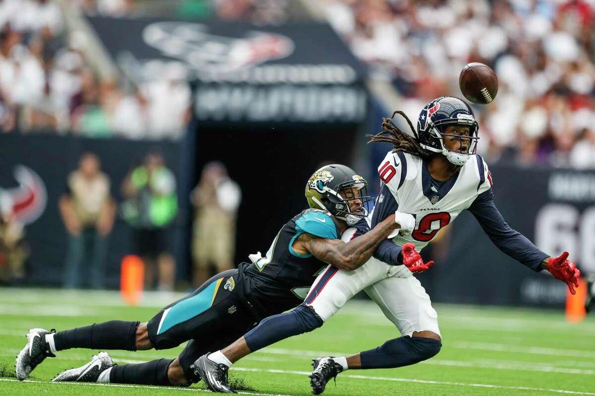 Jacksonville Jaguars cornerback A.J. Bouye (21) breaks up a pass intended for Houston Texans wide receiver DeAndre Hopkins (10) in the first quarter of an NFL football game at NRG Stadium, Sunday, Sept. 10, 2017, in Houston. ( Karen Warren / Houston Chronicle )
