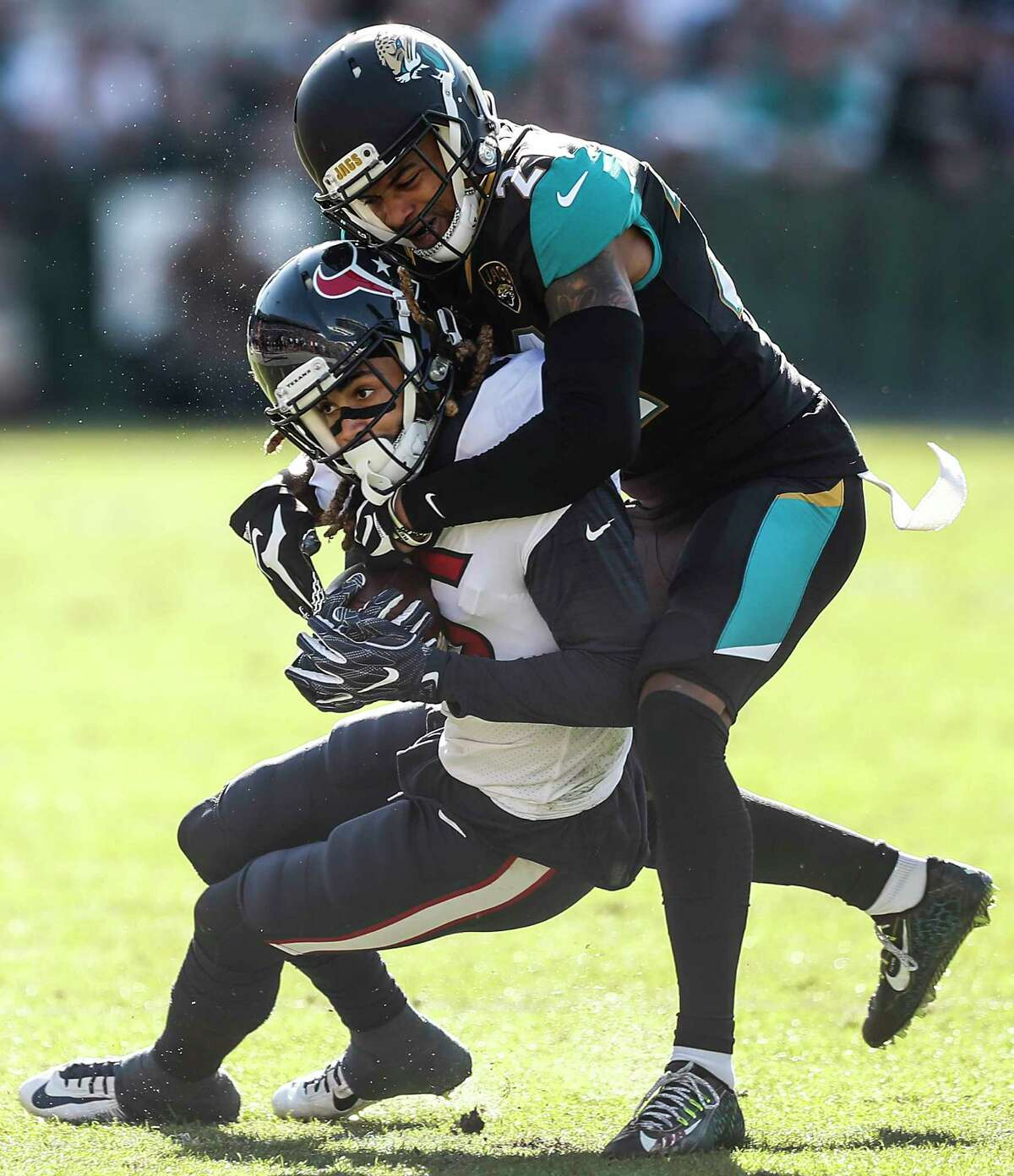 Jacksonville Jaguars cornerback A.J. Bouye (21) tackles Houston Texans wide receiver Will Fuller (15) during the second quarter of an NFL football game at EverBank Field on Sunday, Dec. 17, 2017, in Jacksonville. ( Brett Coomer / Houston Chronicle )
