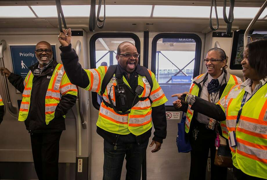 (From left) Transit Station Supervisor Walter Grier, Labor Representative Kevin Alexander, Transportation Supervisor Charlotte Dangerfield and Station Agent Jessica Theus laugh while riding the inaugural first run of Bart's newest train Friday, Jan. 19, 2018 at MacArthur Station in Oakland, Calif. Photo: Jessica Christian, The Chronicle
