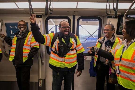 (From left) Transit Station Supervisor Walter Grier, Labor Representative Kevin Alexander, Transportation Supervisor Charlotte Dangerfield and Station Agent Jessica Theus laugh while riding the inaugural first run of Bart's newest train Friday, Jan. 19, 2018 at MacArthur Station in Oakland, Calif.