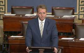 In this image from video from Senate Television, Sen. Jeff Flake, R-Ariz. speaks on the Senate floor, Wednesday, Jan. 17, 2017 at the Capitol in Washington.  IFlake called Trump�s repeated attacks on the media �shameful� and �repulsive� and said Trump �has it precisely backward.�� Flake said despotism is the enemy of the people, while a free press is the despot�s enemy and a guardian of democracy. (Senate TV via AP)