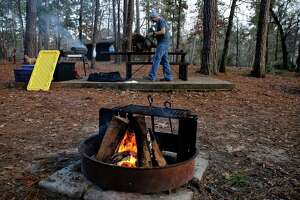 Kevin Tanzi prepares his campsite at Cagle Recreation Area in Sam Houston National Forest Friday, Jan. 19, 2018 in Houston. A government shutdown could impact operations at the national forest.