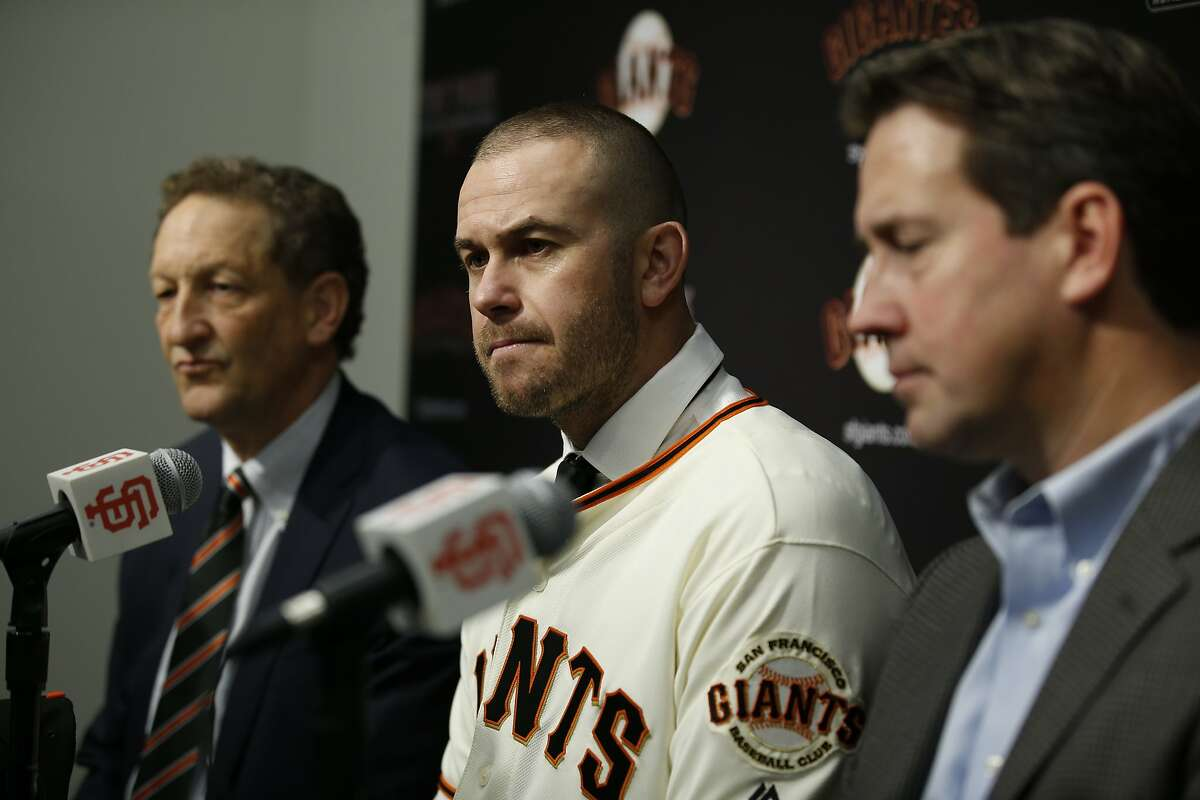 From left: San Francisco Giants CEO Larry Baer, Evan Longoria and general manager Bobby Evans during a news conference at AT&T Park, Friday, Jan. 19, 2018, in San Francisco, Calif. The S.F. Giants introduced Longoria as their new third baseman.
