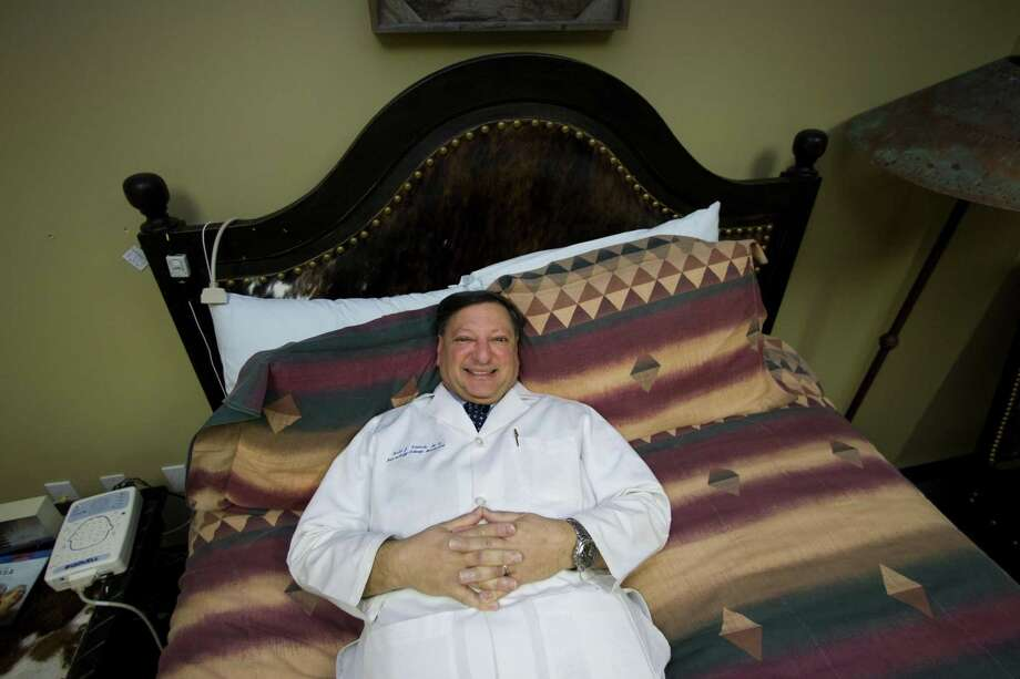Dr. Todd Swick, medical director of the Houston Sleep Center, relaxes in one of his research bedrooms in Houston, where the facility diagnoses and treats people who have problems sleeping. Photo: Johnny Hanson /Chronicle / © 2009 Houston Chronicle