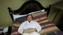 Dr. Todd Swick, medical director of the Houston Sleep Center, relaxes in one of his research bedrooms in Houston, where the facility diagnoses and treats people who have problems sleeping.