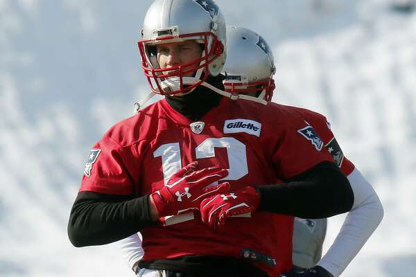 New England Patriots quarterback Tom Brady warms up during an NFL football practice, Friday, Jan. 19, 2018, in Foxborough, Mass. The Patriots host the Jacksonville Jaguars in the AFC championship on Sunday in Foxborough.(AP Photo/Bill Sikes)