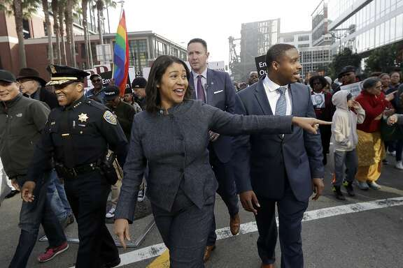 San Francisco acting Mayor London Breed, center, smiles during a march to mark the birthday of slain civil rights leader Martin Luther King Jr. in San Francisco, Monday, Jan. 15, 2018. (AP Photo/Jeff Chiu)