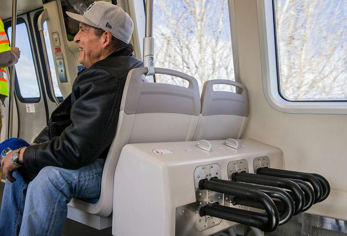 New slots for bicycles are seen on the newest Bart train during its inaugural ride Friday, Jan. 19, 2018 at MacArthur Station in Oakland, Calif.