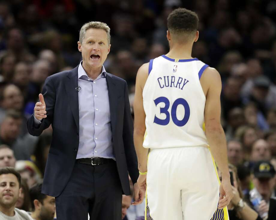 Golden State Warriors head coach Steve Kerr, left, talks with Stephen Curry in the second half of an NBA basketball game against the Cleveland Cavaliers, Monday, Jan. 15, 2018, in Cleveland. (AP Photo/Tony Dejak) Photo: Tony Dejak, Associated Press