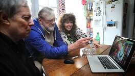 Brian Peron (left), Wayne Justmann (middle), and Lynette Shaw (right) talk about events taking place before Proposition 215 at a table where discussions took place in creating the California Compassionate Use Act on Wednesday, January 10, 2018, in San Francisco, Ca.