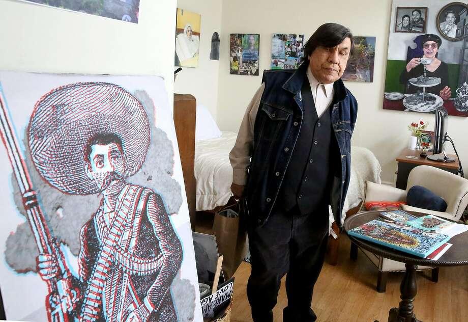 René Yañez gets ready to leave his San Francisco home to do street art. Photo: Liz Hafalia, The Chronicle