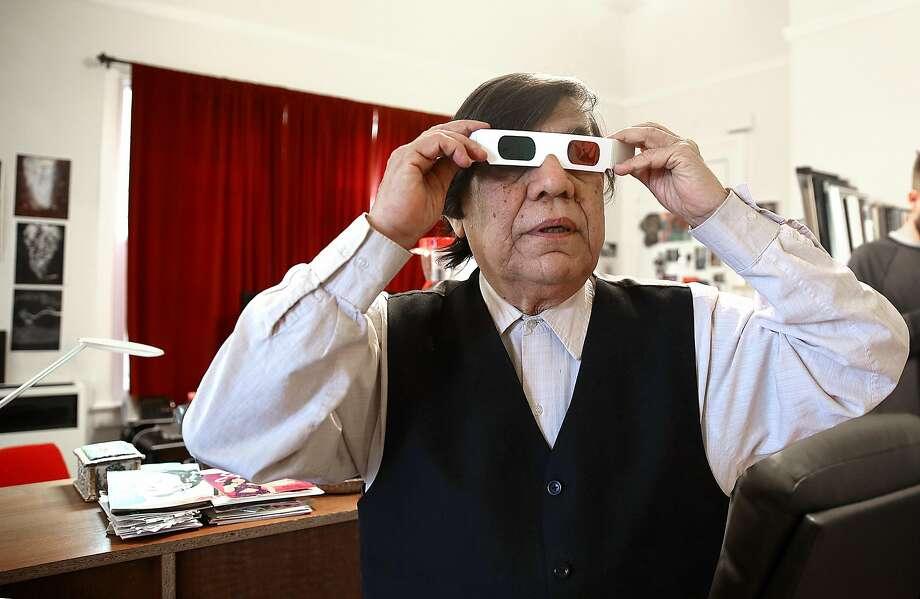 René Yañez checks some of his 3-D artwork at his San Francisco home. Photo: Liz Hafalia, The Chronicle