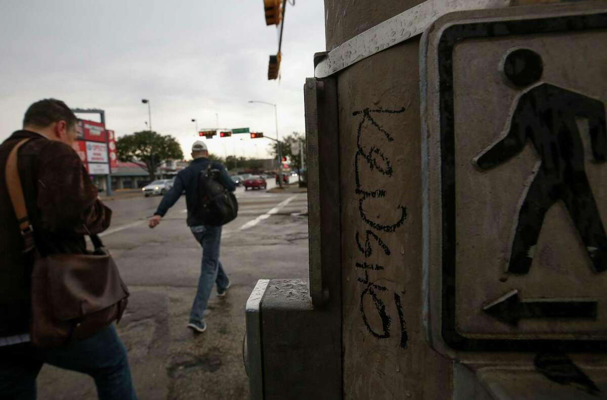 Graffiti tags seen on the intersection of Montrose Boulevard and Westheimer Road Friday, Jan. 19, 2018, in Houston. The Montrose management district has stopped providing graffiti abatement, esplanade maintenance, and other services amid an ongoing legal battle with the area property owners. ( Godofredo A. Vasquez / Houston Chronicle )