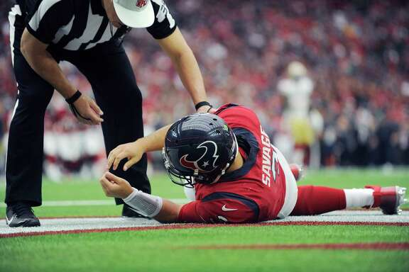 Houston Texans quarterback Tom Savage is checked by a referee after he was hit during the first half of an NFL football game in Houston against the San Francisco 49ers. (AP Photo/Eric Christian Smith, File)