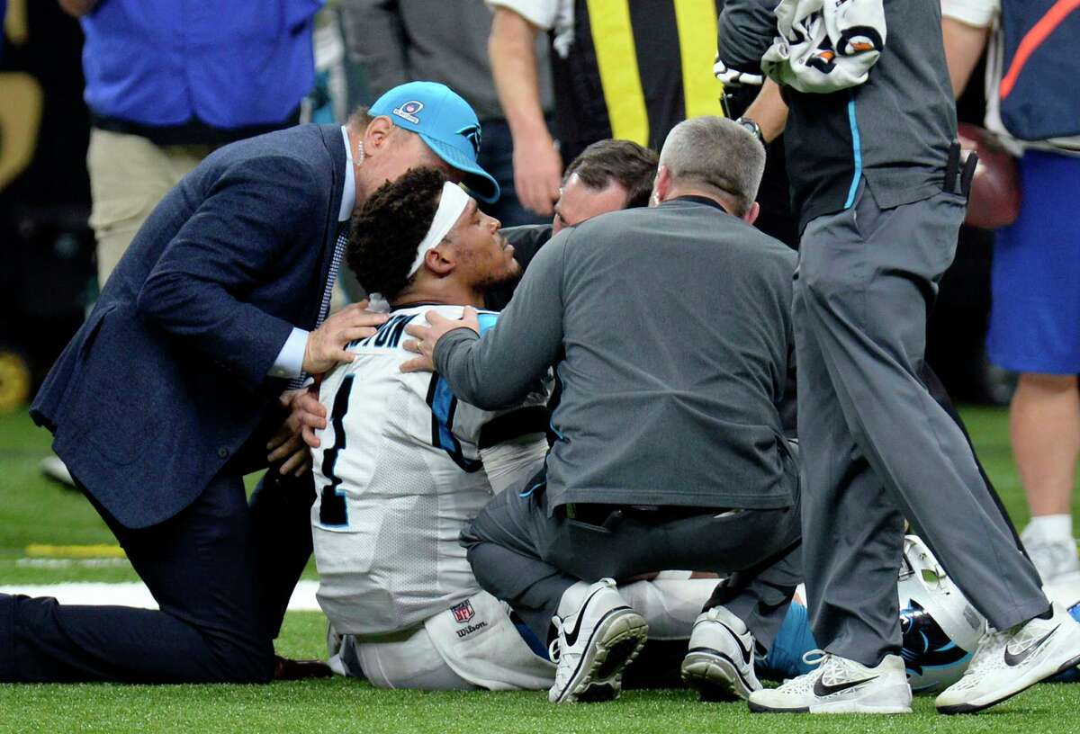 Carolina Panthers quarterback Cam Newton is tended to by medical personnel after being sacked in the second half of an NFL football game in New Orleans against the Saints. (AP Photo/Bill Feig)