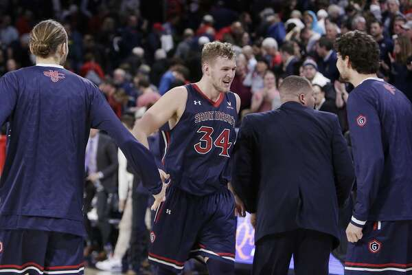 Saint Mary's center Jock Landale (34) celebrates after the team's 74-71 win over Gonzaga in an NCAA college basketball game in Spokane, Wash., Thursday, Jan. 18, 2018. (AP Photo/Young Kwak)