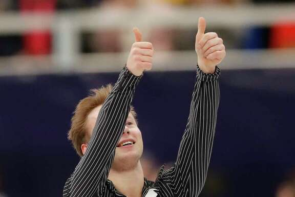 Alexander Majorov of Sweden thumbs up after performing in the men's free skating event at the European figure skating championships in Moscow, Russia, Friday, Jan. 19, 2018. (AP Photo/Pavel Golovkin)