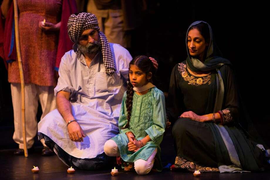 "Boota Singh the Sikh (Chanpreet Singh), his Muslim wife, Zainab (Farah Yasmeen Shaikh) and their daughter, Tanveer (Aziza Noor Shaikh), are torn apart in ""The Parting."" Photo: Regie Lantin, EnActe Arts And Noorani Dance"