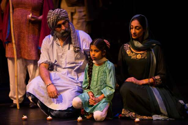 """Boota Singh the Sikh (Chanpreet Singh, left), his Muslim wife Zainab (Farah Yasmeen Shaikh, right) and their daughter Tanveer (Aziza Noor Shaikh, center), torn apart by laws of state, are re-united only in death in """"The Parting,"""" produced by�EnActe Arts and Noorani Dance and performed at Z Space."""