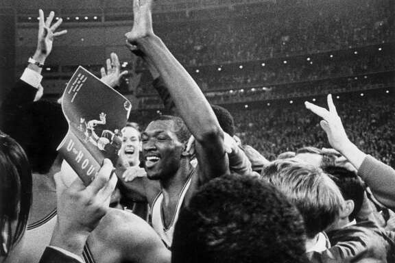 Elvin Hayes celebrates following the University of Houston's win over UCLA basketball,  Jan. 20, 1968, in the Houston Astrodome. (Houston Chronicle file)
