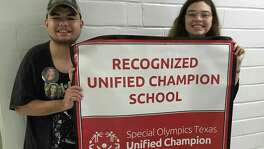 Dominic Cavazos, 18, and Carrie Mullins, 17, are old friends and co-presidents of a club at Alamo Heights High School that was key to the school's integration of disabled students with their peers. It became the first in Texas to be named a Recognized Unified Champion School under a national competition affiliated with the Special Olympics.