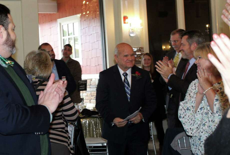 Guests at the Lake Houston Area Chamber of Commerce Annual Awards Extravaganza applaud as 2017 Haden McKay, M.D. Citizen of the Year, Humble Mayor Merle Aaron, makes his way to accept his award at The Overlook in Atascocita on Friday, Jan. 19. Photo: Melanie Feuk