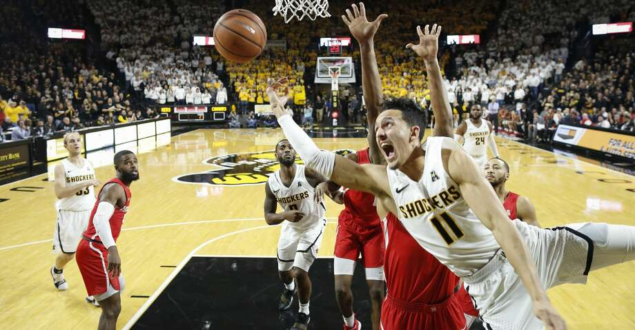 Wichita State's Landry Shamet (11) takes a shot and is fouled against Houston during the second half at Koch Arena on Thursday, Jan. 4, 2018. The host Shockers won, 81-63. (Travis Heying/Wichita Eagle/TNS) Photo: Travis Heying/TNS