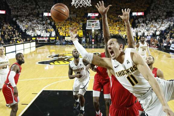 Wichita State's Landry Shamet (11) takes a shot and is fouled against Houston during the second half at Koch Arena on Thursday, Jan. 4, 2018. The host Shockers won, 81-63. (Travis Heying/Wichita Eagle/TNS)