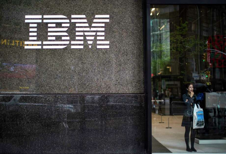In this Wednesday, April 26, 2017, photo, a woman looks out from the lobby next to the logo displayed on the IBM Building in New York. On Thursday, Jan. 18, 2018, IBM Corp. reports financial results. (AP Photo/Mary Altaffer) Photo: Mary Altaffer / Copyright 2017 The Associated Press. All rights reserved.