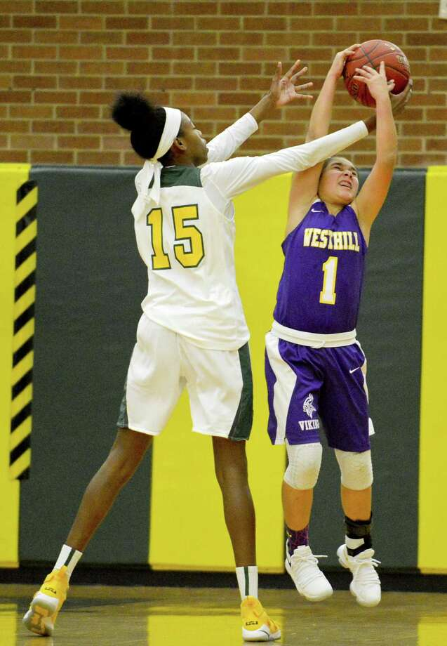 Trinity Catholic's Iyanna Lops (15) fights for a rebound with Westhill's Maddy Bautista (1) in a FCIAC girls basketball game at Trinity Catholic High School's Walsh Court in Stamford, Conn. on Friday, Jan. 19, 2018. Photo: Matthew Brown / Hearst Connecticut Media / Stamford Advocate