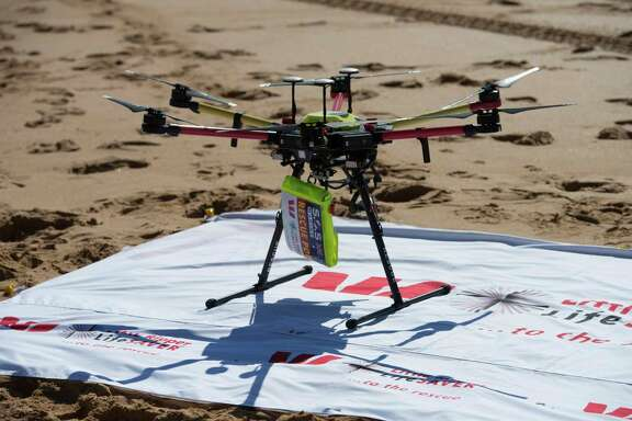 A drone dropped a flotation device to two teens caught in a riptide off the Australian coast Thursday in what officials are describing as a world-first rescue.