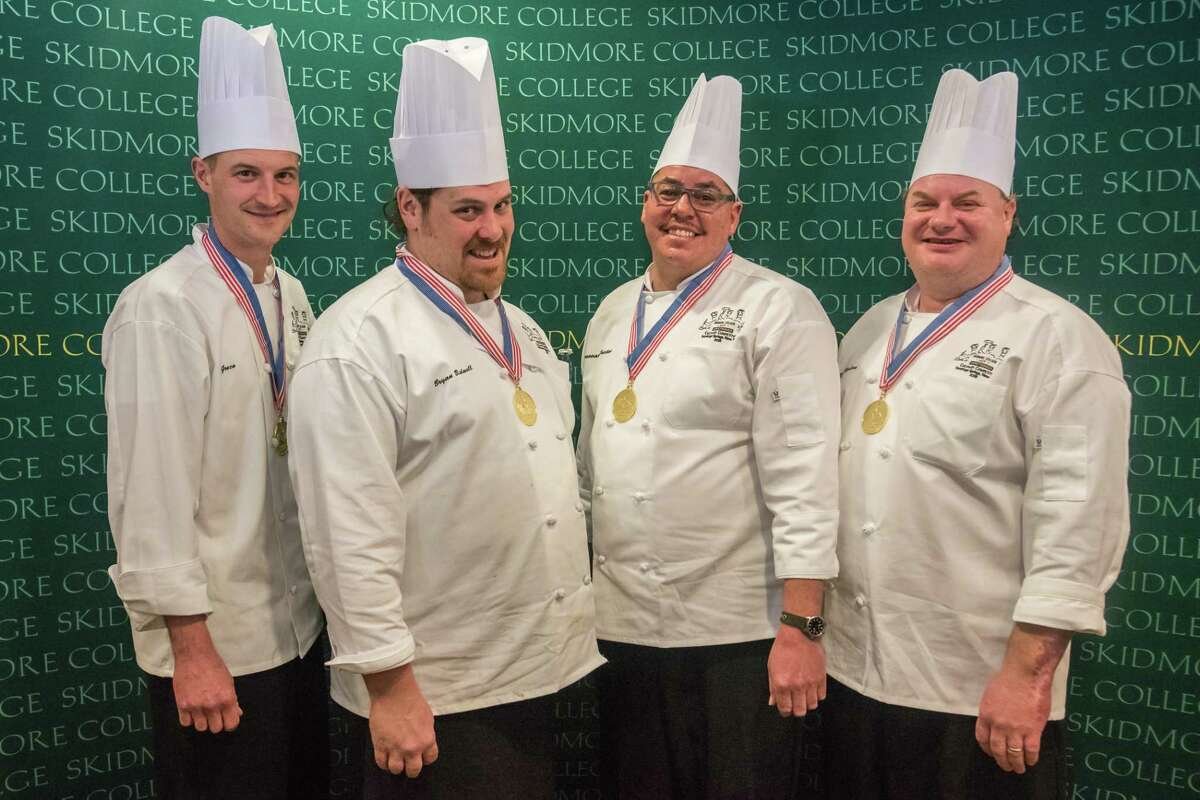 The Skidmore College culinary team, from left, Joe Greco, Bryan Bidwell, Donovan Preston and Paul Karlson earned its fifth consecutive gold medal for culinary excellence in the American Culinary Federation sanctioned competition held Jan. 12 at the Skidmore Campus. Eleven colleges and universities from the Northeast participated.