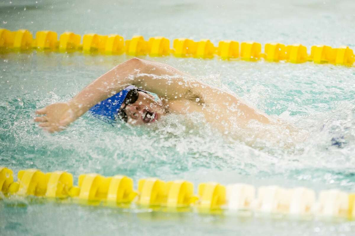 Midland's Zach O'Dell competes in the 400 yard freestyle relay during a meet against Saginaw Heritage on Friday, Jan. 19, 2018 at H. H. Dow High School. (Katy Kildee/kkildee@mdn.net)