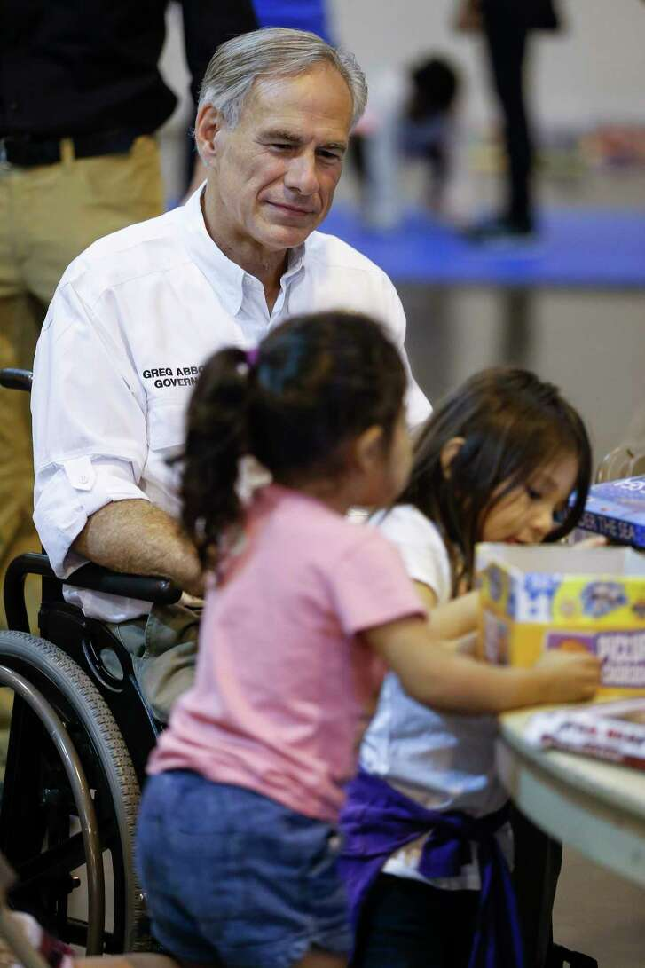 Texas governor Greg Abbott plays with kids while visiting Tropical Storm Harvey evacuees at NRG Center in Houston Saturday, Sept. 2, 2017. ( Michael Ciaglo / Houston Chronicle)