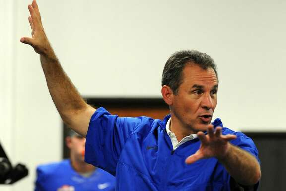 After the stadium lost power, HBU head coach Vic Shealy explains the situation to players in the weight room during the first half of a college football game against SFA, Saturday, October 18, 2014, at Husky Stadium in Houston. (Photo: Eric Christian Smith/For the Chronicle)