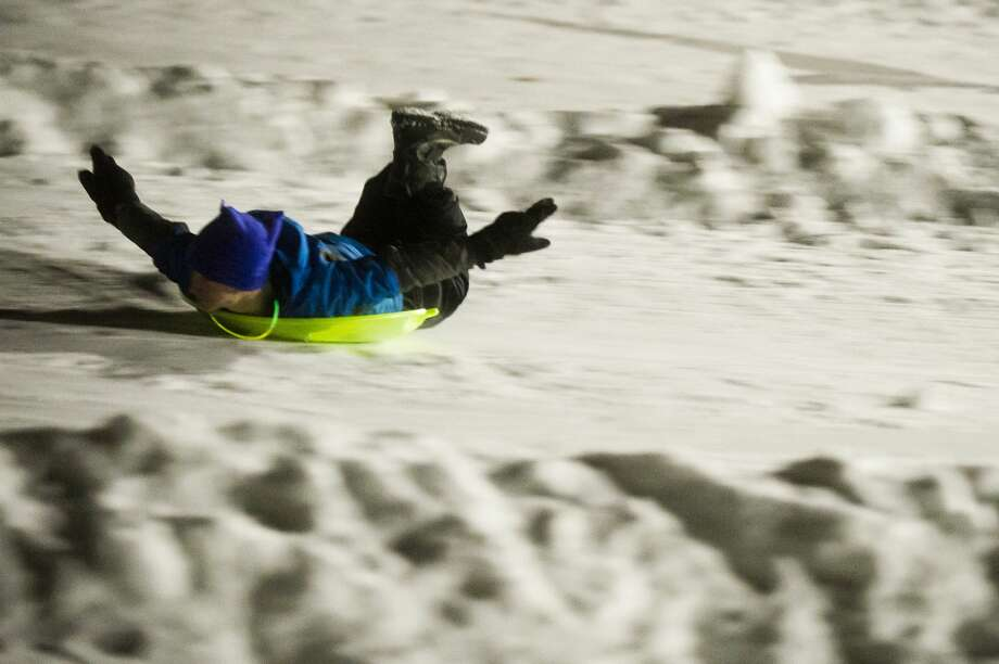 People fly down the sledding hill during the Snow and Glow event at Midland City Forest on Friday, Jan. 19, 2018. (Katy Kildee/kkildee@mdn.net) Photo: (Katy Kildee/kkildee@mdn.net)