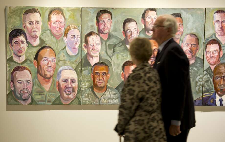Midlanders and others come to look at artwork by former President George W. Bush 01/19/18 at the exhibit, Portraits of Courage, at Museum of the Southwest. Tim Fischer/Reporter-Telegram Photo: Tim Fischer/Midland Reporter-Telegram