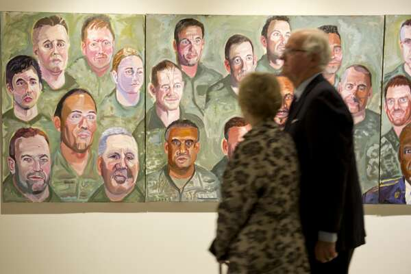 Midlanders and others come to look at artwork by former President George W. Bush 01/19/18 at the exhibit, Portraits of Courage, at Museum of the Southwest. Tim Fischer/Reporter-Telegram