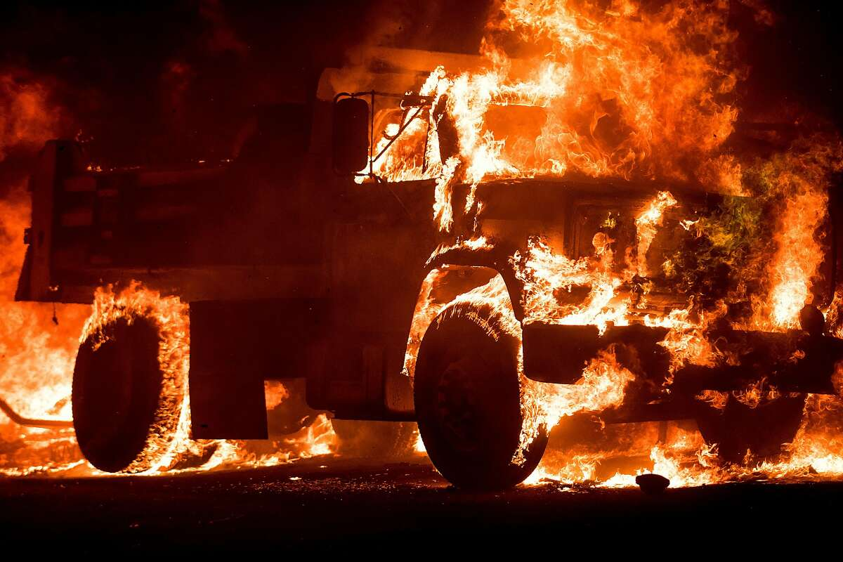 Flames consume a truck on Soda Canyon Road in Napa, Calif., on Monday, Oct. 9, 2017.