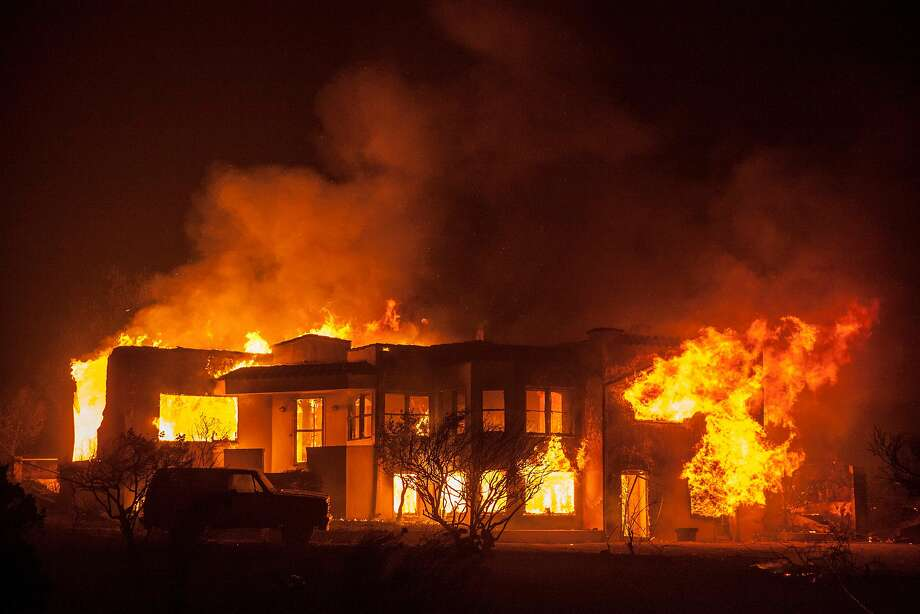 A ranch home along Hwy. 12 burned out of control as a fast moving wind whipped wild fire raged though the Napa/Sonoma wine region in NAPA, CALIFORNIA, USA 9 Oct 2017.   Multiple fire have erupted in Napa, Sonoma, Calistoga and the Santa Rosa area, burning homes and wineries. Mandatory evacuations have be displaced hundreds of residents through out the area. Photo: Peter DaSilva, Special To The Chronicle